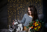 Beautiful girl in a Christmas atmosphere with puppies Husky - 183691746