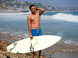 Quadro Surfing concept. Action sports model hold surfboard. What to do in California beach vocation.