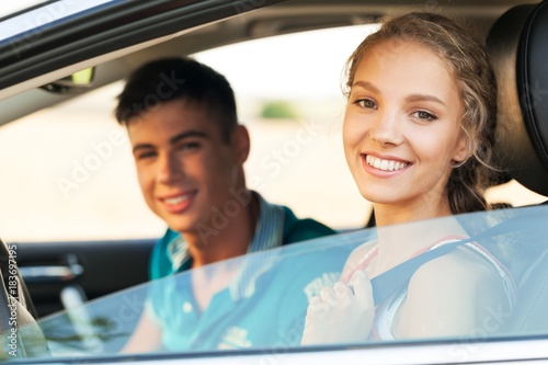 Portrait of Young Couple in a Car