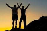 Two Men Celebrating on Mountain Top