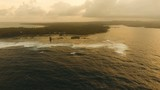 Viewpoint in the ocean at Cloud Nine surf point at sunset, Siargao island , Philippines. Aerial view raised wooden walkway for surfers to cross the reef of siargao island to cloud 9 surf break - 183699373
