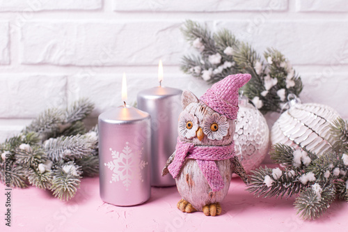 Decorative bird owl, silver candles, branches fur tree and balls