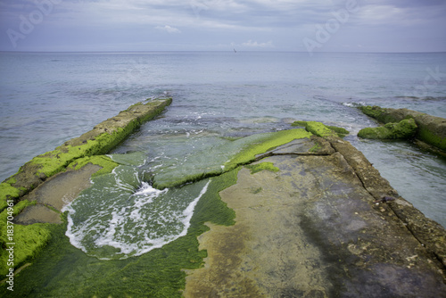 Staande foto Havana Shoreline with mossy rocks in East Havana beach, Cuba