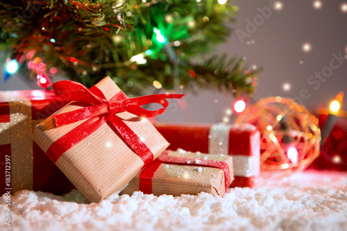 Christmas background with christmas balls, gifts and decoration - 183712397