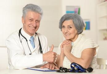 Senior doctor with elderly patient