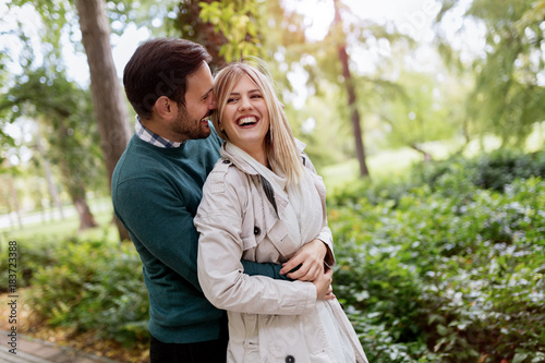 Beautiful loving couple going for walk outdoors