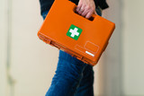 Man with first aid kit runs to help - 183724348