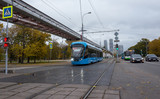 Blue electric tram on the background of the cityscape.