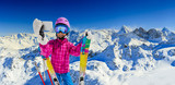 Teenager taking a selfie, girl taking a self portrait with mobile phone, sport skiing having fun on winter vacation. - 183728574