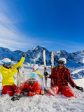 Happy family enjoying winter vacations in mountains. Playing with snow, Sun in high mountains. Winter holidays. - 183728930