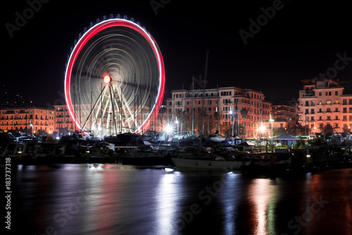 Plexiglas Bruggen Night view of the ferris wheel on the seaside in Salerno, Italy