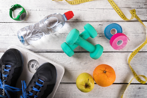 Poster fitness equipment and accessories on white wood background. flat lay