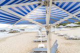 deckchairs and parasols at an empty beach - 183738170
