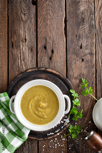 Vegetable cream soup, puree on wooden rustic table, top view