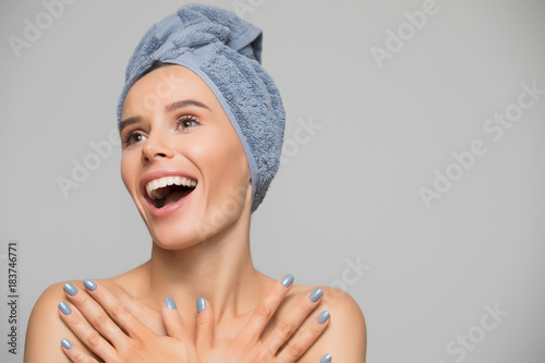 Beautiful spa smiling woman isolated on grey background Poster