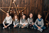 Children are standing against the background of the New Year's star - 183751325