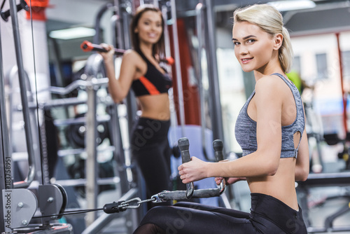 happy sportive women working out at gym