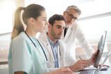 Medical team checking Xray results - 183762375