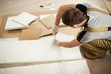 Man assembling furniture - 183766710