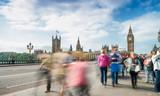 Tourists walking along Westminster Bridge in London. Long exposure shot - 183777732