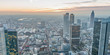 Aerial view of metropolis skyline at dusk, business concept