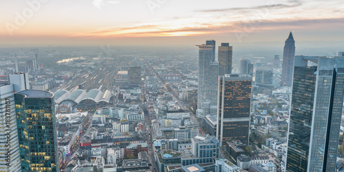 Fototapeta Aerial view of metropolis skyline at dusk, business concept