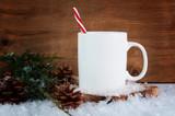 white mug in a seasonal christmas scene
