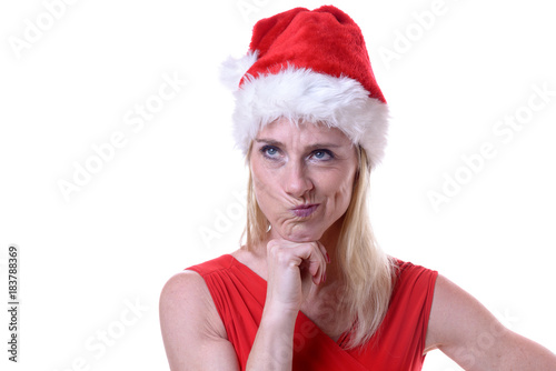 Defiant irate woman in a festive red Santa Hat