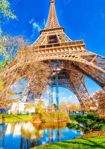 Plagát Upward view of Eiffel Tower on a beautiful sunny winter day - Pa