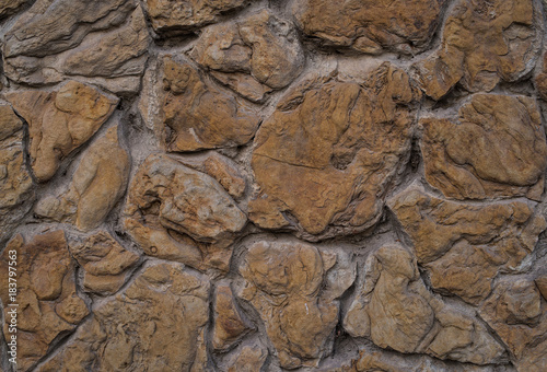Fototapeta texture rough stone, embossed stone texture, wall made of stone