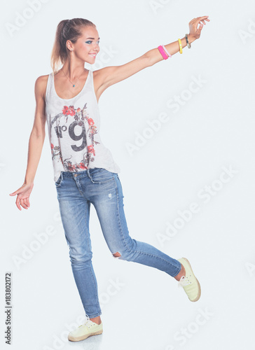Attractive young woman standing isolated on white background