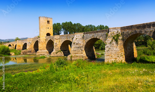 Wall mural old  bridge over Ebro. Frias, Province of Burgos