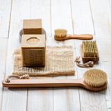 simple traditional solid soaps, exfoliating loofah and wooden body brushes - 183809352