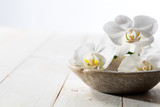 fragrance still life with pure white orchids in stone cup - 183809500