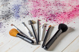Fashion still life with makeup brushes with explosion of colors - 183809594