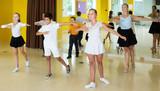 Children learn dance movements