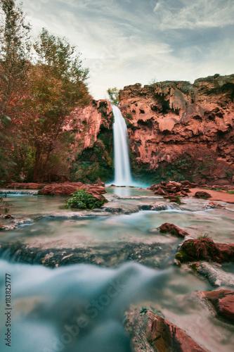 Fotobehang Diepbruine Beautiful Blue Waterfall coming out of canyon
