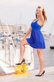 Woman standing one leg on marina bitt - 183842790