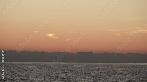 Sky after sunset over sea water surface, Greece Peloponnese, time lapse