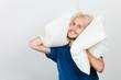 Man playing with pillows, good sleep concept
