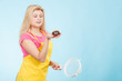 Woman holding chocolate cupcake and colander