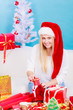 Young woman preparing gifts for Christmas