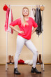 Woman standing in wardrobe picking winter outfit