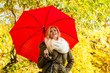 Woman walking in park with umbrella