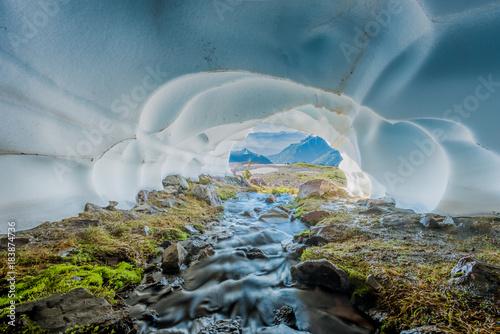 Creek Flows Through Snow Cave