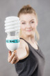 Woman holding eco modern light bulb