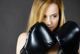 Boxer girl exercise with boxing gloves. - 183878185