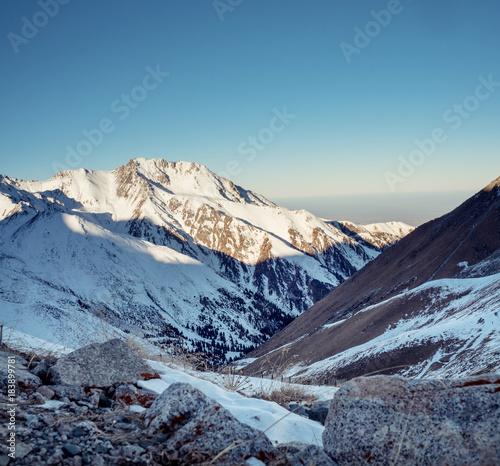Foto op Aluminium Blauwe jeans Winter walk in mountains of Zailiysky Ala Tau Almaty Kazakhtan
