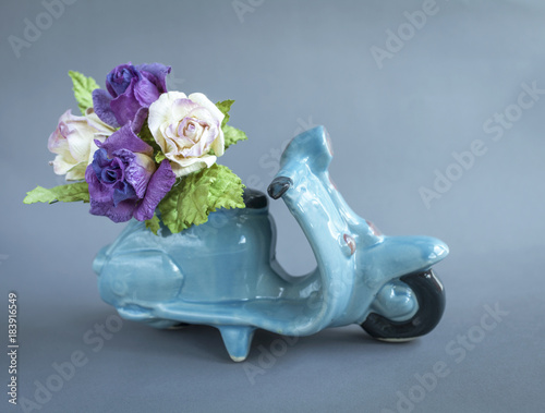 Foto op Canvas Scooter Rose paper flower on ceramic blue scooter, flower delivery service concept