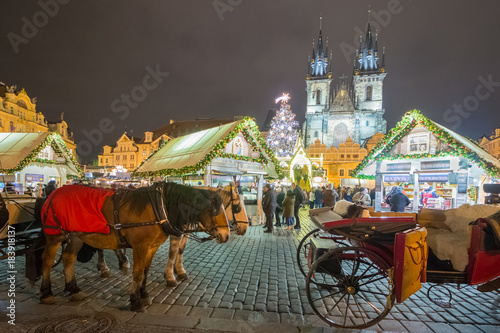 Tuinposter Praag Christmas Markets on the Old Town Square in Prague with Team of Horses in the foreground.